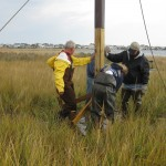 Volunteers finish installing an osprey nesting platform on an island on Barnegat Bay.  Ben Wurst