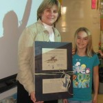 Mrs. Rosander and student (notice the t-shirt) with adoption certificate