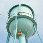 We raise up the nestbox onto the water tower.  Kathy Clark, ENSP