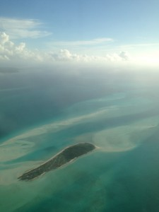 Aerial view of one of several hundred Bahamas islands and cays, with tidal flats, highly suitable piping plover habitat, visible stretching around the island.