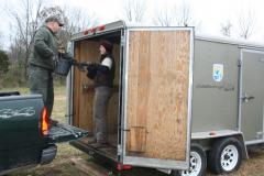 Image of Beth Ciuzio (right) of the US Fish and Wildlife Service hands off a truckfull of trees to Fred Tenore of Hillsborough Township's Parks and Recreation Department.