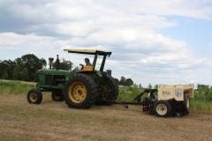 Image of Patricia Hilton seeding native warm-season grasses at her farm in Hunterdon County (June 2010).
