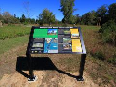 Image of Large interpretive sign at Ballanger Creek informs visitors about the habitat enhancement performed on site, value of habitat management, and the wildlife that occur in the area