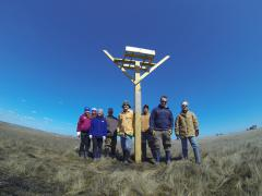 Image of Volunteers proudly stand in front of the osprey nesting platform on Cedar Run that was installed to replace the one lost to the storm surge associated with Sandy. Ospreys return to the same nest site each year, so installing a new platform was critical to helping the population in NJ remain at a sustainable level.