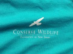 Image of Our logo is on the front left pocket area of both the men's and women's shirts.