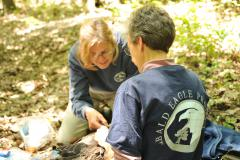 Image of Zoologist Kathy Clark, ENSP and Dr. Erica Miller attach the GPS transmitter to E/05.