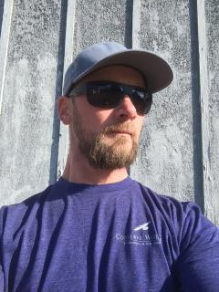 Image of Habitat Program Manager, Ben Wurst sports an indigo CWF t-shirt.