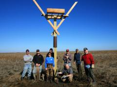 Image of Volunteers stand in front of a new osprey platform that was installed in Fortescue, NJ.