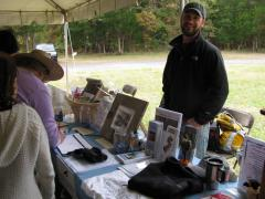 Image of Ben Wurst mans a CWF table at an event at Forsythe NWR in Oceanville.