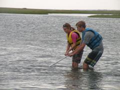 Image of Jahvin T. and Ellie J. rake for clams in Barnegat Bay.