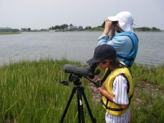 Image of Bobby H. watches birds alongside CWF biologist Ben Wurst.