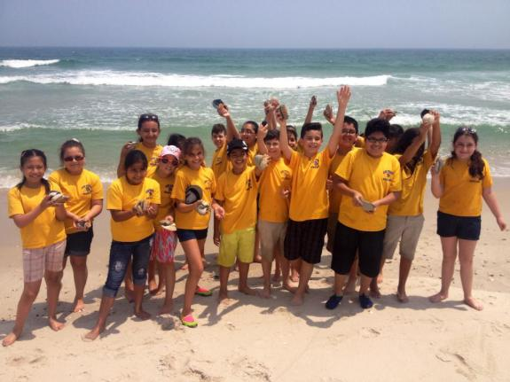 "Image of Students from Ann Street School in Newark posing for their ""Shell-fie"" at Island Beach State Park."